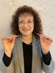 Karen holding Sing Ring and OOVO straw necklace